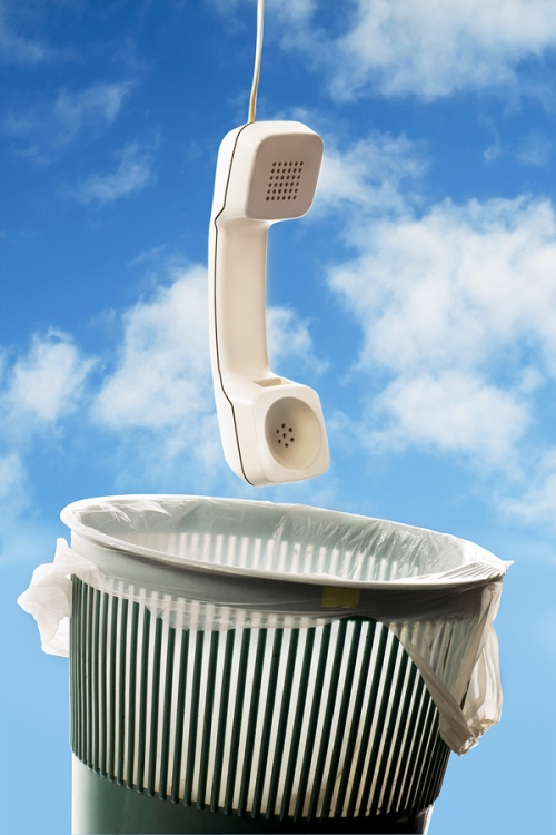 Telephone in trash can